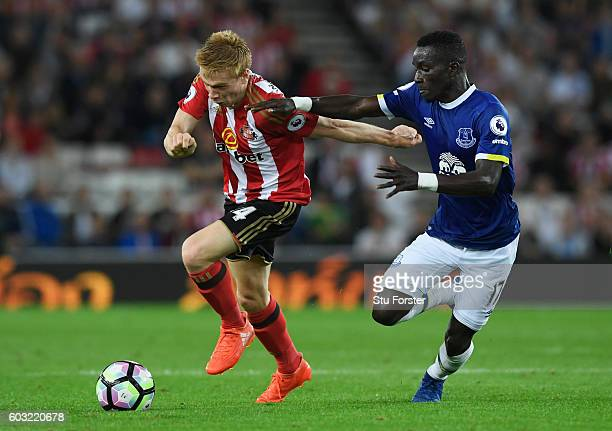 Duncan Watmore of Sunderland holds off Idrissa Gueye of Everton during the Premier League match between Sunderland and Everton at Stadium of Light on...