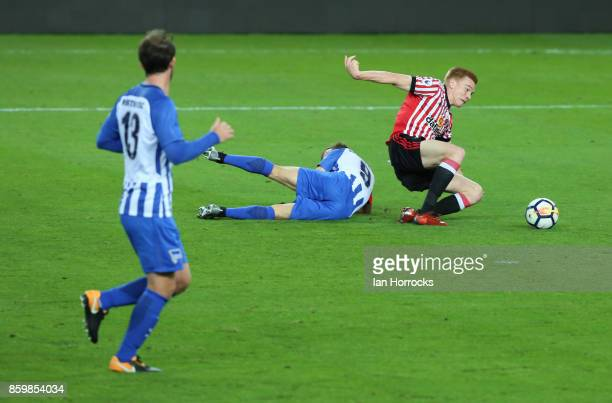Duncan Watmore of Sunderland is brought down during the Premier League International Cup match between Sunderland U23 and Hertha Berlin U23 at...