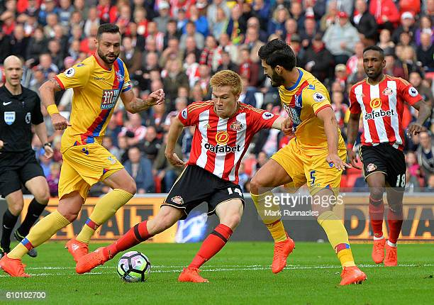 Duncan Watmore of Sunderland is tackled by James Tomkins of Crystal Palace during the Premier League match between Sunderland FC and Crystal Palace...