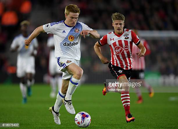 Duncan Watmore of Sunderland takes the ball past Lloyd Isgrove of Southampton during the EFL Cup fourth round match between Southampton and...