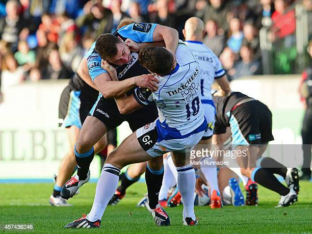 Duncan Weir of Glasgow Warriors and George Ford of Bath Rugby tangle during the European Rugby Champions Cup match between Glasgow Warriors and Bath...
