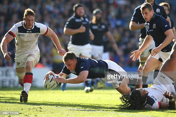Duncan Weir of Scotland scores his teams fifth try during the 2015 Rugby World Cup Pool B match between Scotland and USA at Elland Road on September...