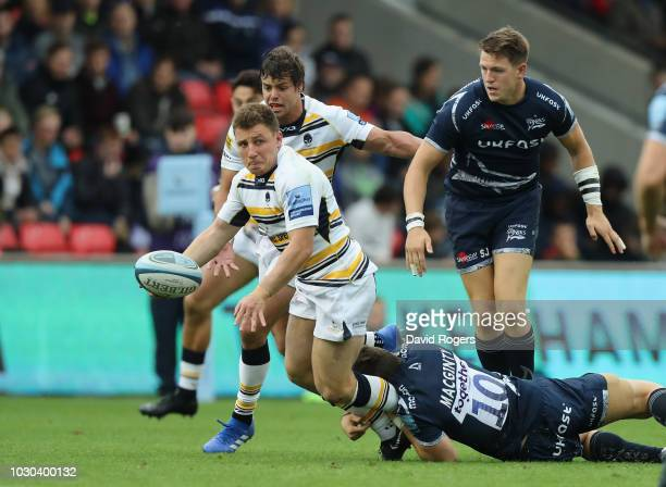 Duncan Weir of Worcester Warriors is tackled by AJ MacGinty during the Gallagher Premiership Rugby match between Sale Sharks and Worcester Warriors...