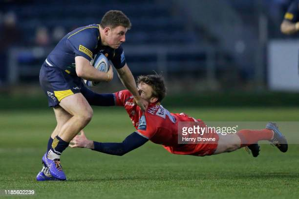 Duncan Weir of Worcester Warriors is tackled by Simon Hammersley of Sale Sharks during the Gallagher Premiership Rugby match between Worcester...
