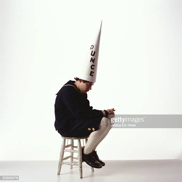 dunce - dunce's hat stock pictures, royalty-free photos & images