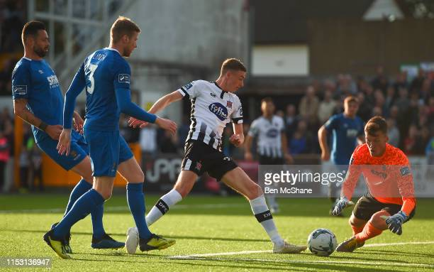 Dundalk Ireland 1 July 2019 Daniel Cleary of Dundalk has a shot on goal despite the attention of Waterford players from left Kenny Browne Kevin Lynch...
