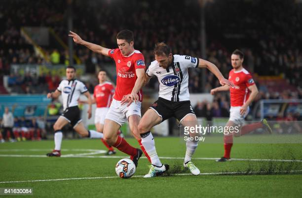 Dundalk Ireland 1 September 2017 David McMillan of Dundalk in action against Lee Desmond of St Patricks Athletic during the SSE Airtricity League...