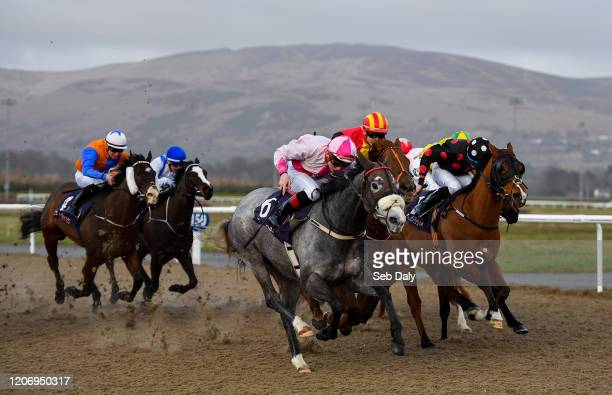 Dundalk Ireland 13 March 2020 Zippity near with Gavin Ryan up races alongside eventual winner Danz Gift with Ronan Whelan up red and yellow hat on...