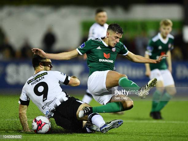 Dundalk Ireland 25 September 2018 Eoin Toal of Derry City in action against Patrick Hoban of Dundalk during the SSE Airtricity League Premier...