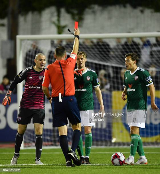 Dundalk Ireland 25 September 2018 Kevin McHattie of Derry City is shown a red card by referee Paul McLaughlin during the SSE Airtricity League...