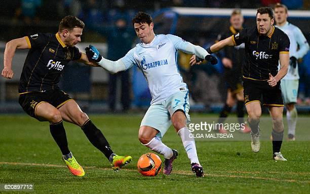 Dundalk's Irish defender Andy Boyle and Dundalk's Irish defender Brian Gartland vie for the ball with Zenit St Petersburg's Brazilian midfielder...