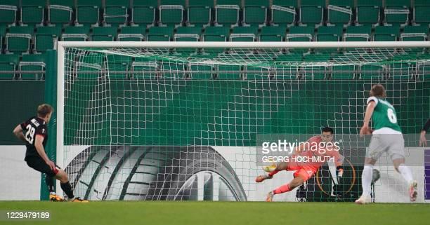 Dundalk's Irish forward David McMillan scores a penalty past Rapid Wien's Austrian goalkeeper Paul Gartler during the UEFA Europa League Group B...