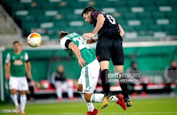 Dundalk's Irish forward Patrick Hoban scores the 0-1 goal past Rapid Wien's Austrian defender Maximilian Hofmann during the UEFA Europa League Group...