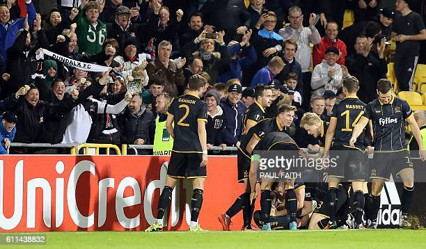 Dundalk's Irish striker Ciaran Kilduff is mobbed by teammates as he celebrates scoring his team's first goal during the UEFA Europa League group D...