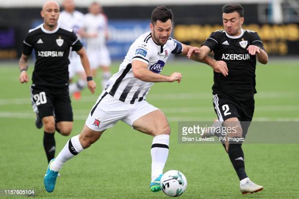 Dundalk's Patrick Hoban and Qarabag's Gara Garayev battle for the ball during the UEFA Champions League second qualifying round first leg match at...