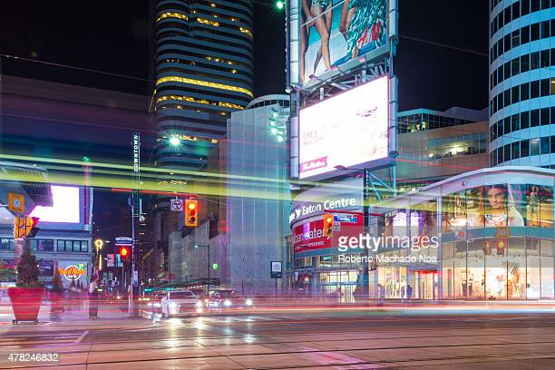 Dundas Square long exposure looking south Evening city with bright lights and advertising signs on buildings