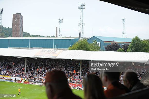 Dundee fans watch the match between Dundee United and Dundee with their home ground Dens Park in the background during the Scottish Premier League...