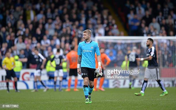 Dundee FC goalkeeper Scott Bain walks from the pitch after being sent off during the Ladbrokes Scottish Premiership match between Dundee United FC...