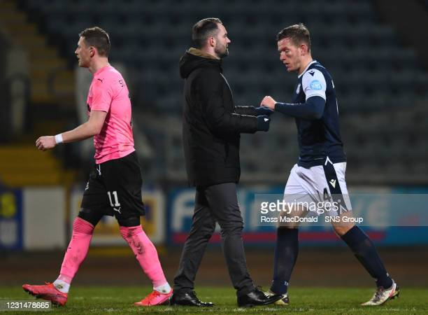 Dundee manager James McPake celebrates at full time with Lee Ashcroft during a Scottish Championship match between Dundee and Inverness Caledonian...