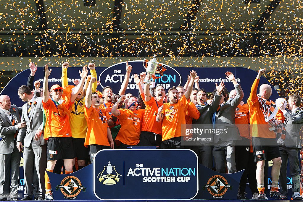 Dundee United captain Andy Webster lifts the trophy after victory during the Active Nation Scottish FA Cup Final between Dundee United and Ross County at Hampden Stadium on May 15, 2010 in Glasgow, Scotland.