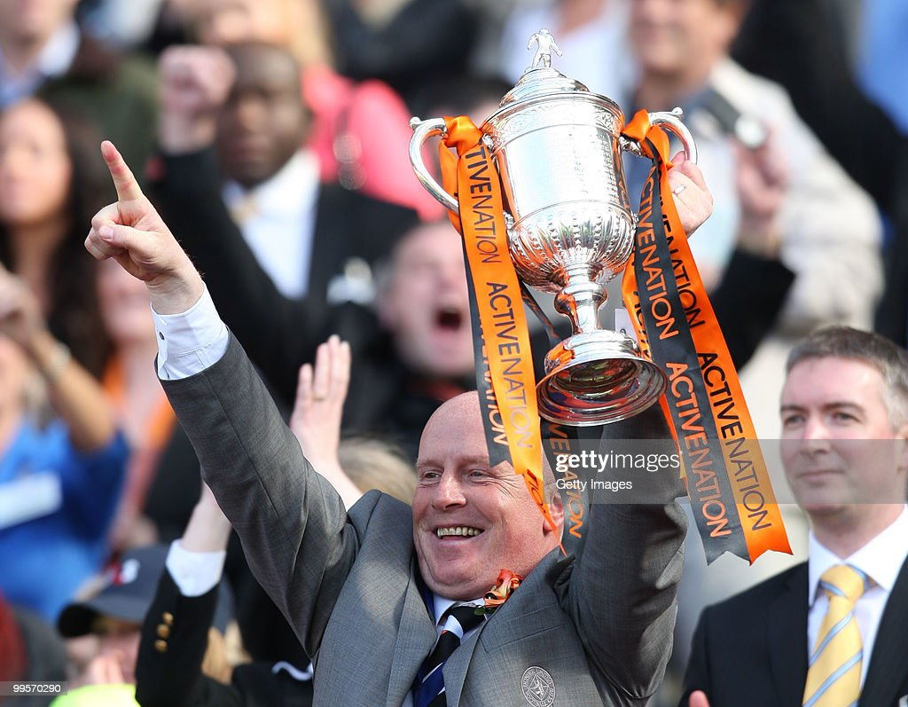 Dundee United manager Peter Houston lifts the trophy after victory during the Active Nation Scottish FA Cup Final between Dundee United and Ross County at Hampden Stadium on May 15, 2010 in Glasgow, Scotland.