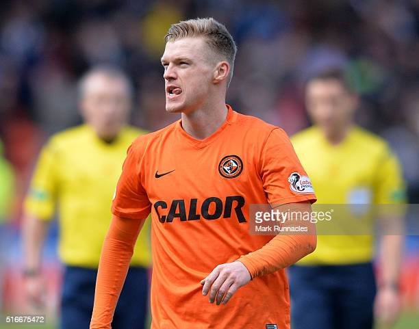 Dundee United's Billy McKay applauds the Dundee United fans as he walk from the pitch after scoring two goal during the Ladbrokes Scottish...