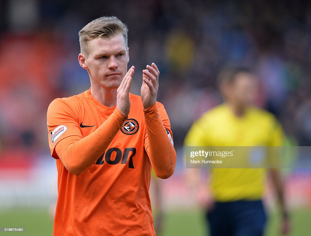 Dundee United's Billy McKay applauds the Dundee United fans as he walk from the pitch after scoring two goal during the Ladbrokes Scottish Premiership match between Dundee United FC and Dundee FC at Tannadice Park on March 20, 2016 in Dundee, Scotland.