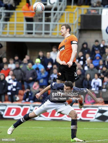 Dundee United's Brian McLean heads from Dundee's Lewis Toshney during the Clydesdale Bank Scottish Premier League match at Tannadice Park Dundee