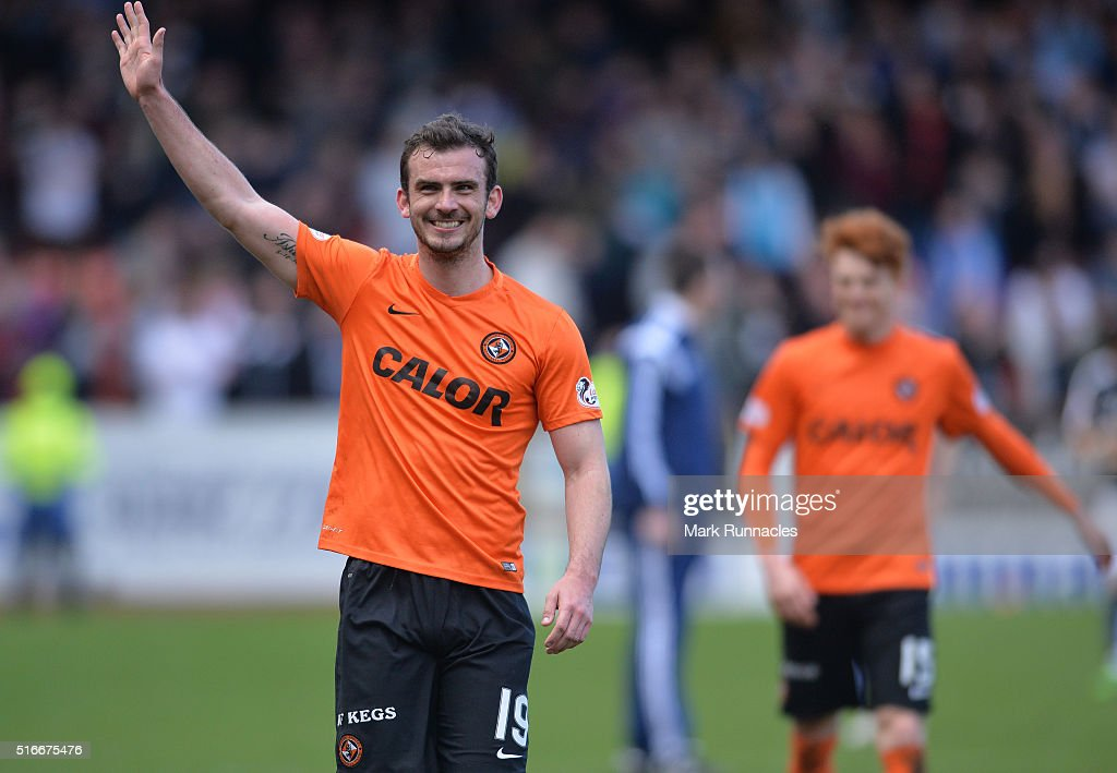 Dundee United's Gavin Gunning applauds the Dundee United fans as he walk from the pitch at the final whistle during the Ladbrokes Scottish Premiership match between Dundee United FC and Dundee FC at Tannadice Park on March 20, 2016 in Dundee, Scotland.