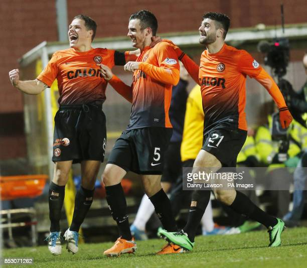 Dundee United's Gavin Gunning celebrates his 2nd goal with team mates John Rankin and Nadir Ciftci during the Scottish Premiership match a Tannadice...