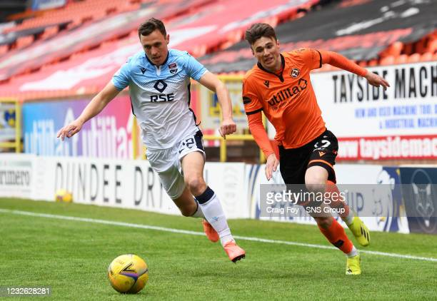 Dundee United's Jamie Robson competes with Jordan Tillson during a Scottish Premiership match between Dundee United and Ross County at Tannadice...