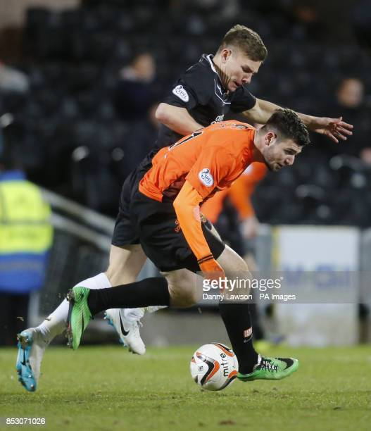 Dundee United's Nadir Ciftci and Motherwell's Shaun Hutchinson battle for the ball during the Scottish Premiership match a Tannadice Park Dundee