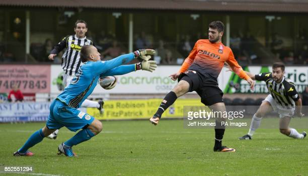 Dundee United's Nadir Ciftci beats Marion Kello to score first goal during the Scottish Premier League match at Tannadice Park Dundee