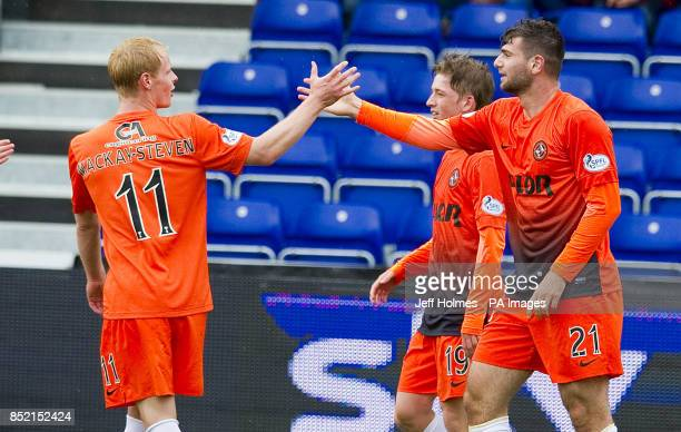 Dundee United's Nadir Ciftci celebrates his goal with Gary MackaySteven during the Scottish Premiership match at the Global Energy Stadium Dingwall