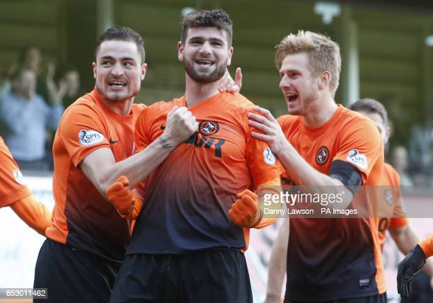 Dundee United's Nadir Ciftci celebrates his goal with teammates Paul Paton and Stuart Armstrong during the Scottish Cup Fifth Round match at...