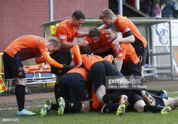 Dundee United's Nadir Ciftci celebrates his goal with teams during the Scottish Cup Fifth Round match at Tannadice Park Dundee