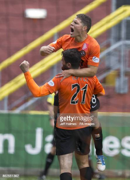 Dundee United's Nadir Ciftci celebrates with ohn Rankin during the Scottish Premier League match at Tannadice Park Dundee