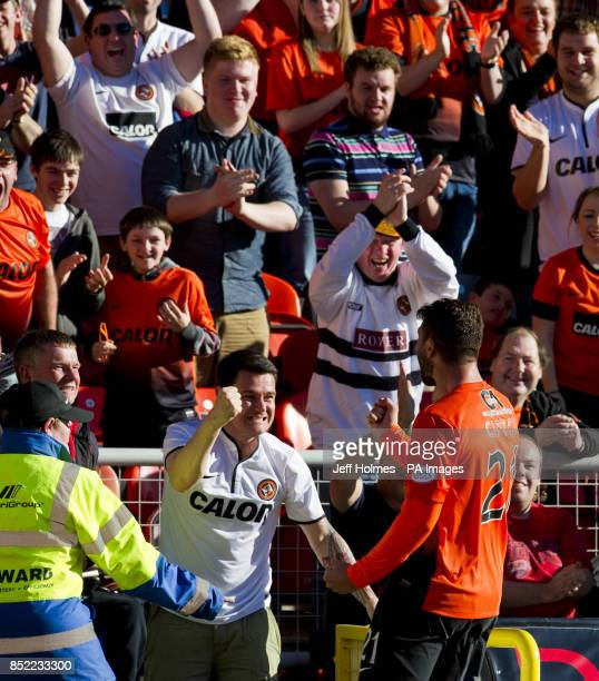Dundee United's Nadir Ciftci celebrates with the fans after scoring during the Scottish Premiership match at Tannadice Park Dundee