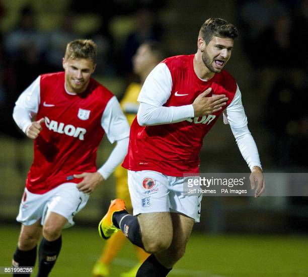 Dundee United's Nadir Ciftci front celebrates his equalizing goal with teammate David Goodwillie during the Scottish League Cup Second Round match at...
