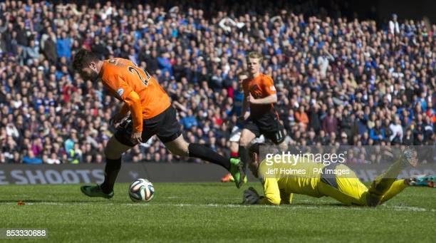 Dundee United's Nadir Ciftci rounds Rangers keeper Steve Simonsen to score his goal during the William Hill Scottish Cup Semi Final match at Ibrox...