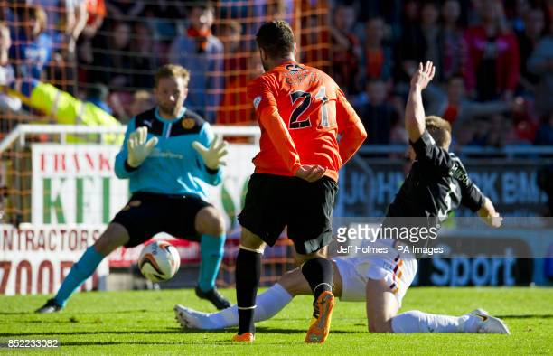 Dundee United's Nadir Ciftci scores the equalising goal during the Scottish Premiership match at Tannadice Park Dundee