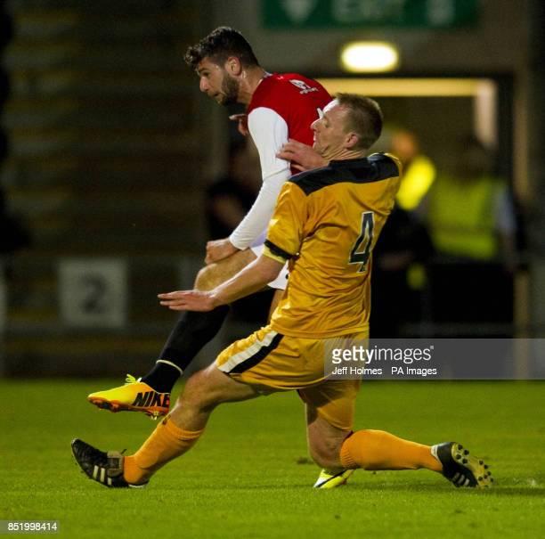 Dundee Uniteds Nadir Ciftci scores the winning goal during the Scottish League Cup Second Round match at Dumbarton Football Stadium Dumbarton