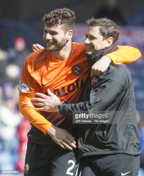 Dundee United's Nadir Ciftci with manager Jackie Mcnamara after the William Hill Scottish Cup Semi Final match at Ibrox Glasgow