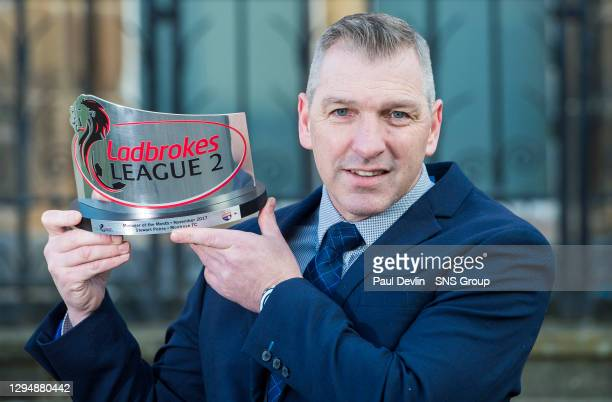 Montrose manager Jim Petrie is pictured with the Ladbrokes League Two Manager of the Month award for November