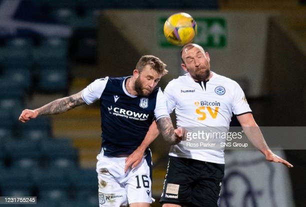 Dundee's Christie Elliott and Michael Moffat of Ayr battle for a header during the Scottish Championship match between Dundee and Ayr United at the...