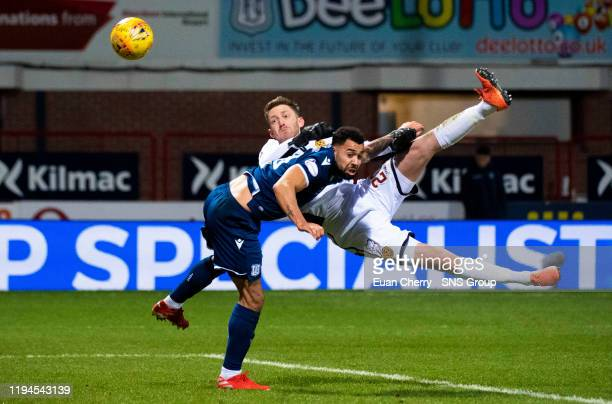Dundee's Kane Hemmings is pictured in action with Motherwell's Mark Gillespie during the William Hill Scottish Cup match between Dundee and...