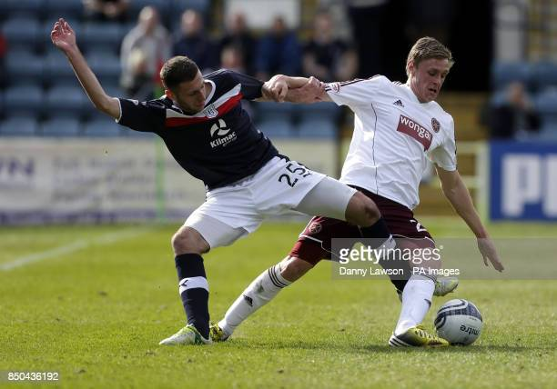 Dundee's Lewis Toshney and Heart's Kevin McHattie battle for the ball during the Clydesdale Bank Scottish Premier League match at Dens Park Dundee