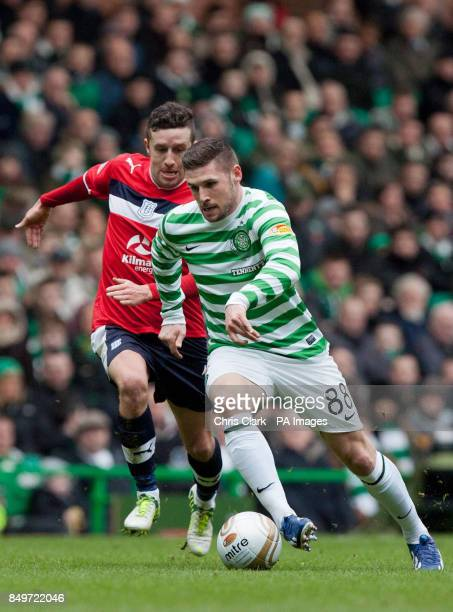 Dundee's Ryan Conroy looks to tackle Celtic's Gary Hooper during the Clydesdale Bank Scottish Premier League match at Celtic Park Glasgow