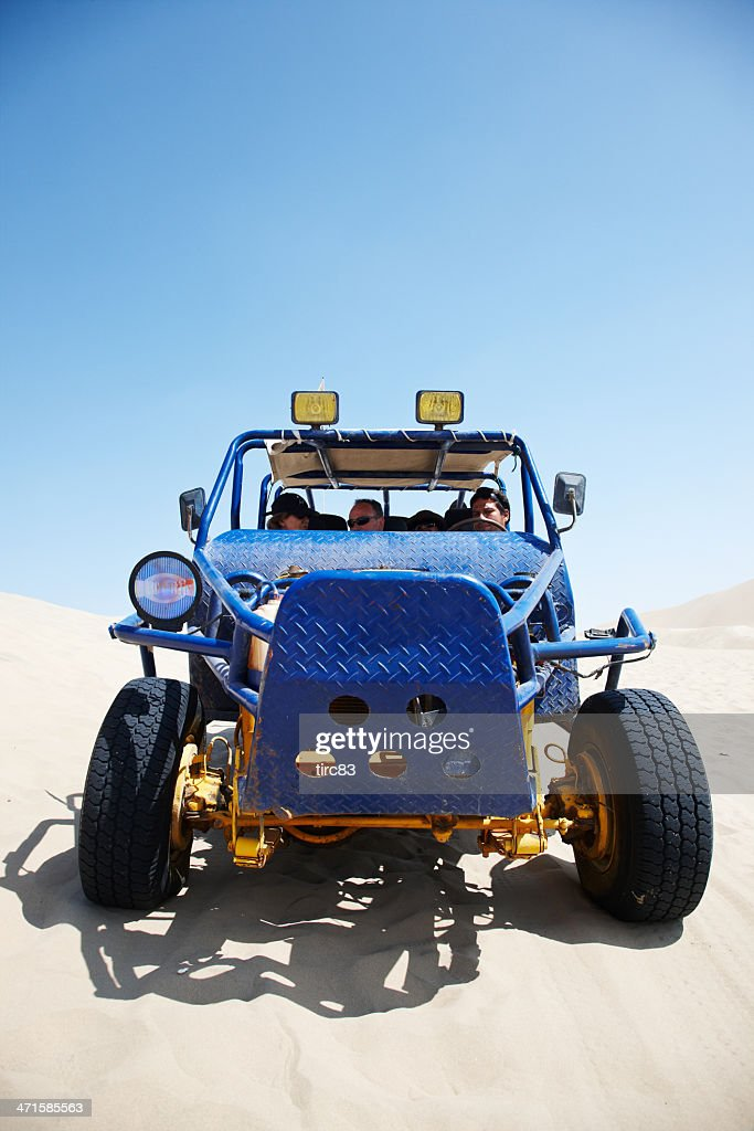 Dune buggy riding in Peruvian desert : Stock Photo