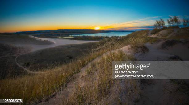 dune climb sunrise - michigan stock pictures, royalty-free photos & images